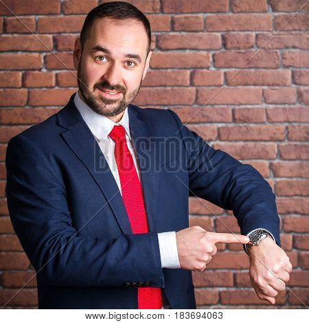 Businessman Is Pointing At The Clock