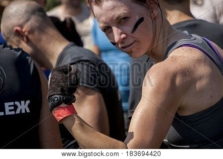 A Woman Is Showing Her Muscles During Physical Competition