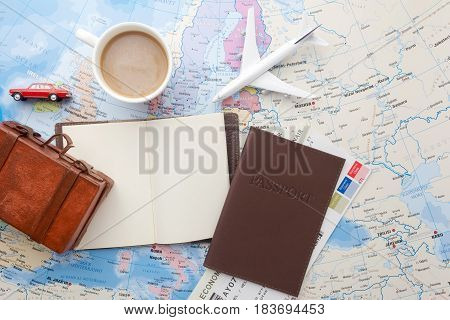 Travel , trip vacation, tourism mockup - close up note book, suitcase, toy airplane on map. Empty space you can place your text or information.