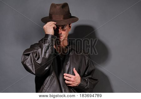 The sexy detective is tipping his hat.