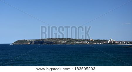 Panoramic view of Manly and North Head from Long Reef Headland on a sunny day (Sydney NSW Australia).