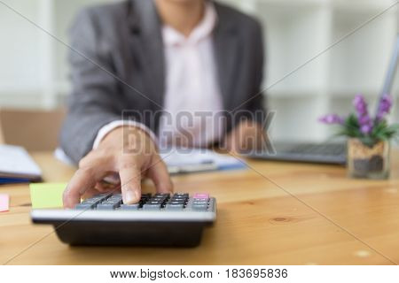 Business Person Using A Calculator To Calculate The Numbers. Accounting , Accountancy, Calculation C