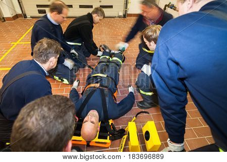 Hamburg, Germany - February 07, 2013: German firefighter team in an exercise with a injured in a stretcher