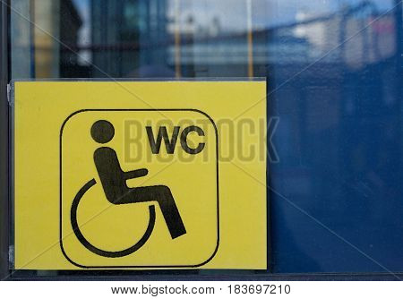 Sign on an elevator to a disabled toilette in the train station of Magdeburg