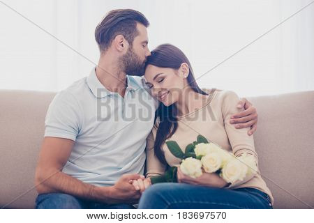 Happy Romantic Husband Giving Bouquet Of White  Flowers To Her Lovely Wife Because Of Her Birthday