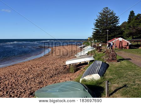 Collaroy Australia - Apr 9 2017. Fishing boats on Fishermans beach at Long Reef Headland on a sunny afternoon (Sydney NSW Australia).