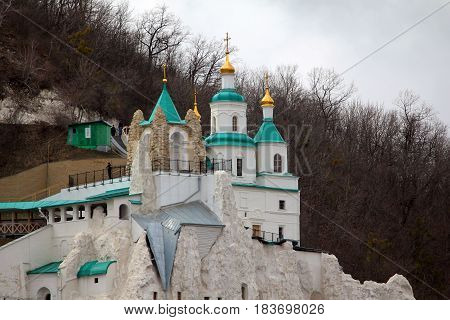 SVYATOGORSK, UKRAINE - APRIL 10, 2011: This is the upper temple on the chalk cliff of the Holy Assumption Svyatogorsk Lauvra.