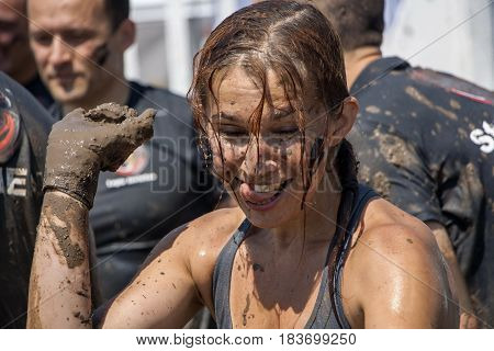 A Woman Having Fun With The Mud After Strength Race