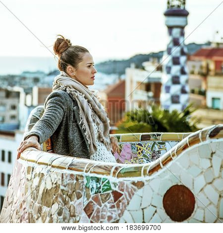 Tourist Woman In Barcelona, Spain In Winter Sitting On Bench