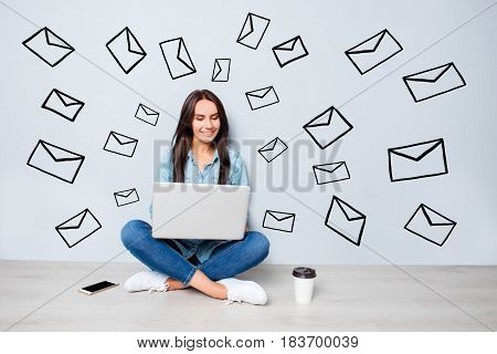Concept Of Modern Lifestyle. Young Friendly  Pretty Happy Student Sitting On Floor And Typing On Lap