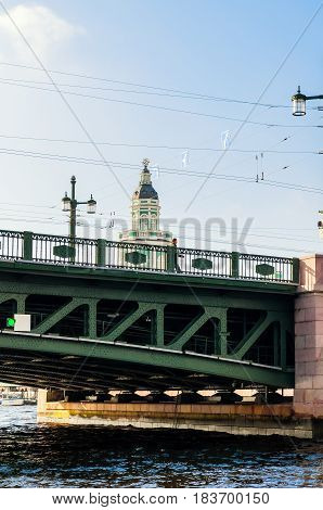 ST PETERSBURG, RUSSIA- OCTOBER 3,2016. Palace bridge and Kunstkamera building near the Neva river in St Petersburg Russia. Architecture ensemble of St Petersburg landmarks in sunny weather