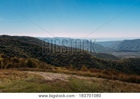 Beautiful landscape of a mountain ridge and a blue sky in the summer season. View of the Black Sea Marcothsky Range Gelendzhik Russia