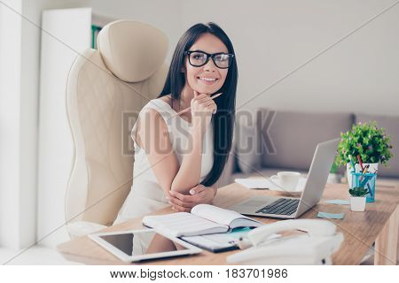 Success Conception. Portrait Of Gorgeous Young Businesslady In Glasses Sitting At Her Workplace In T