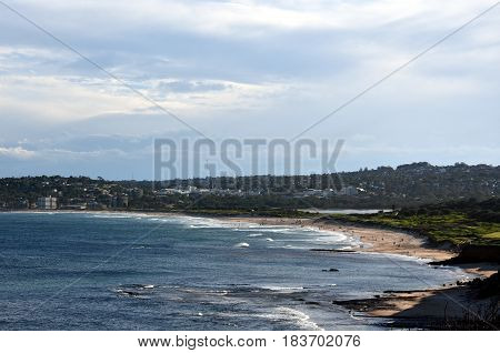 Panoramic view of Dee Why beach on a sunny day from Long Reef Headland (Sydney NSW Australia). A great place to relax as the beach is mainly frequented by locals.