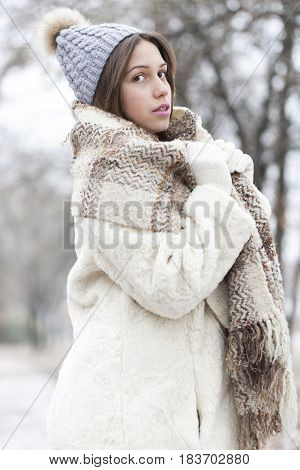 Portrait Of A Young And Beautiful Woman In A Fur Coat With Cap And Scarf