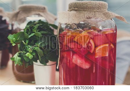 Closeup of lemonades in glass jars at restaurant background. Refreshing drinks in craft containers on bar counter
