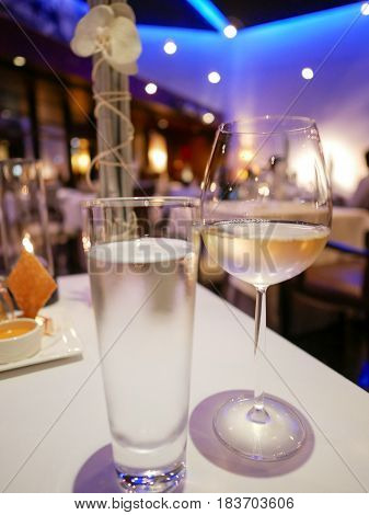 Wine glass and glass of water in fine dining restaurant.