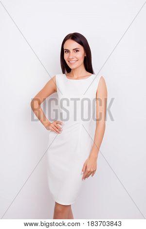 Portrait Of Beautiful Elegant Girl On White Background. She Is Wearing Stylish Smart White Dress And