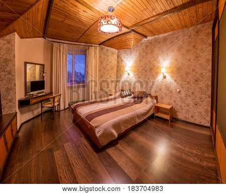 Beige bedroom with wooden floor. Sweet home