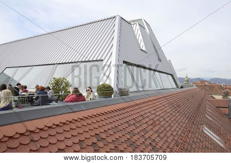 GRAZ, AUSTRIA - MARCH 20, 2017: People at sky bar and roof of the Kastner and Ohler warehouses in Graz the capital of federal state of Styria Austria.