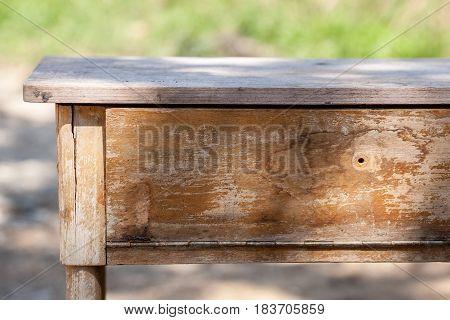 Empty wooden table ith garden. Bokeh background.