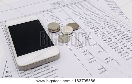 Mobile smart phone and money bank statement finance concept