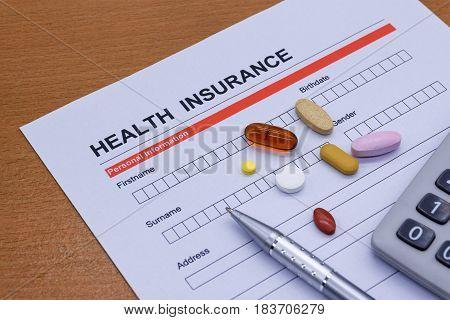 Health insurance paperwork medicine stethoscope. Health insurance claim concept.