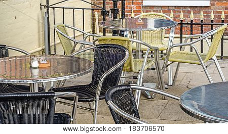 Metal tables and wicker chairs restaurant front restaurant garden catering industry outside
