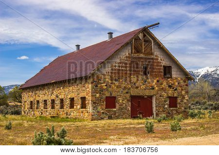 Boarded Up Barn With River Rock Siding In High Desert