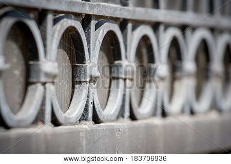 The fragment of a forged metal gate, closeup. Selective focusing