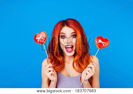 Portrait Of Stylish Funny Happy Carefree Girl With Ginger Hair Holding Sweet Gingerbread With Red He