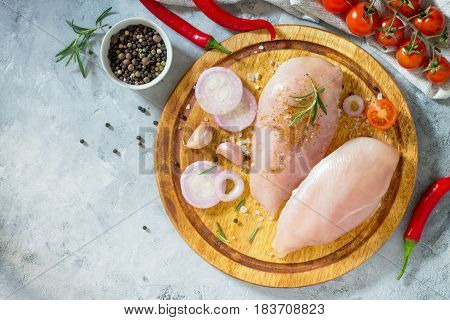Fresh Meat. Chicken Fillet With Chili, Spices And Rosemary On A Cutting Board. Top View.