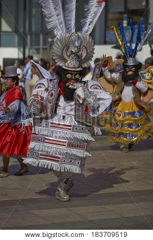 ARICA, CHILE - FEBRUARY 11, 2017: Masked Morenada dancers performing during a street parade at the annual Carnaval Andino con la Fuerza del Sol in Arica, Chile.