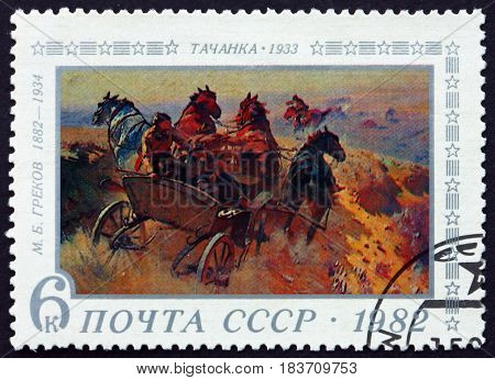 RUSSIA - CIRCA 1982: a stamp printed in Russia shows Tatchanka Painting by M. B. Grekov Russian Painter circa 1982
