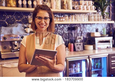 Smiling Lady Working In Coffee Shop