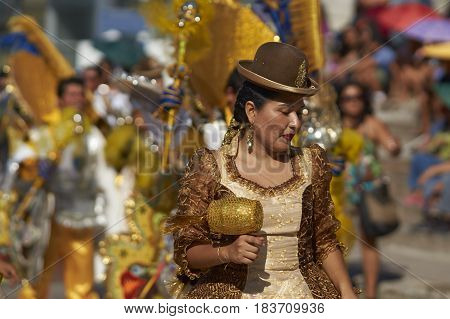 ARICA, CHILE - FEBRUARY 11, 2017: Morenada dancer performing during a street parade at the annual Carnaval Andino con la Fuerza del Sol in Arica, Chile.