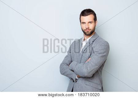 Portrait Of Handsome Successful Respected Businessman In Formal Clothing Standing With Crossed Hands