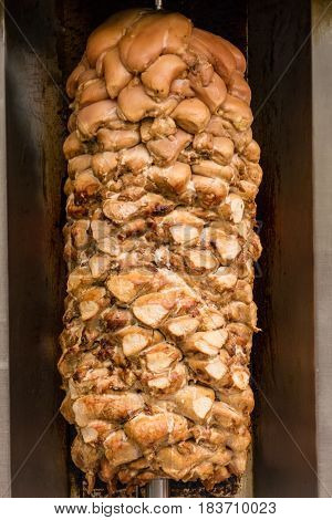 Shawarma meat being prepared on a spit