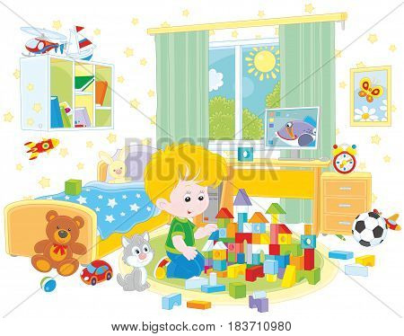 Little boy playing with bricks in his room