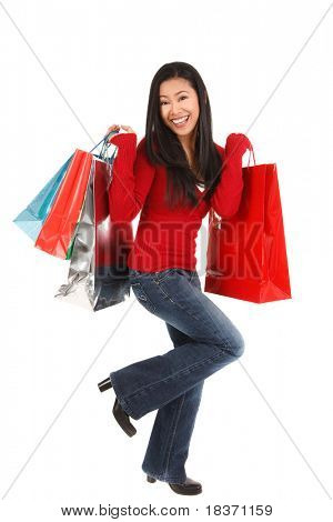happy smiling asian female shopper holding shopping bags isolated on white background