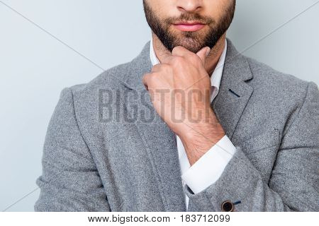 Close Up Cropped Photo Of Minded Young Man In Formalwear Touching His Chin