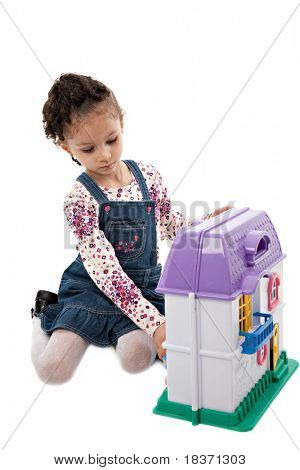Little Cute Girl Playing with Dollhouse Toy Isolated on White Background
