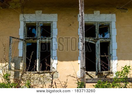 Roztots'ka Pastil' Ukraine - April 25 2017: Windows of an abandoned old house made of adobe on the outskirts of the village in the south-western Ukraine.