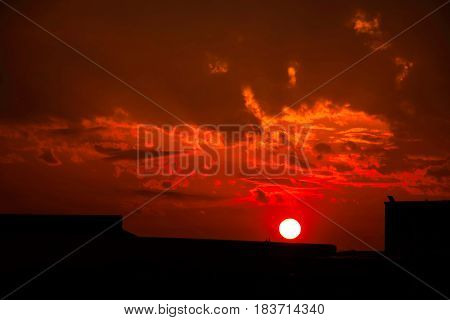 Blood red sunset over the town of Plovdiv Bulgaria