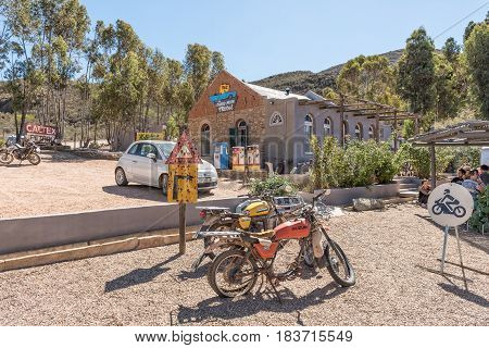 BARRYDALE SOUTH AFRICA - MARCH 25 2017: Old motorcycles and a motel in Barrydale a small town on the scenic Route 62 in the Western Cape Province