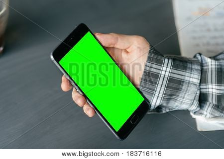 Business man using smart phone with green screen for internet and email. Sequence Concepts of using mobile technologies and smarfon in mobile applications