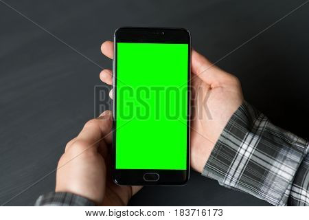 Business man using smart phone with green screen for internet and email. Sequence Concepts of using mobile technologies and smarfon