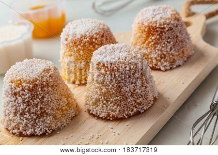 Small homemade cakes with white aniseed sprinkles.