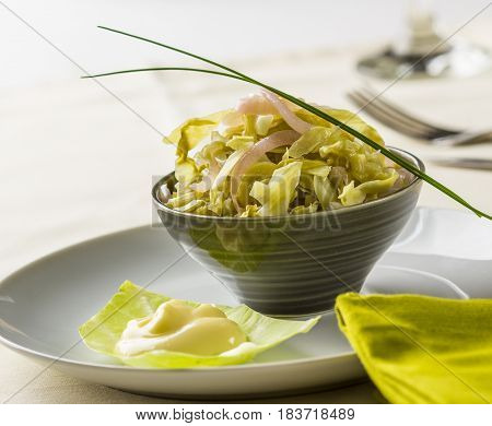 Raw collard greens salad served with mayonnaise.