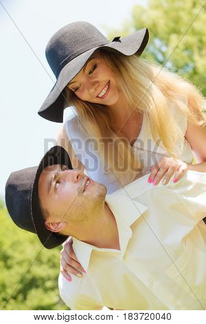 Love romantic walks concept. Man and blonde woman in sun hats having romantic date in park happy being together.